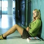 Girl sitting in school hallway