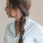 Woman with fishtail braid hairstyle