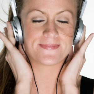 Woman Listening to Headphones --- Image by © Royalty-Free/Corbis